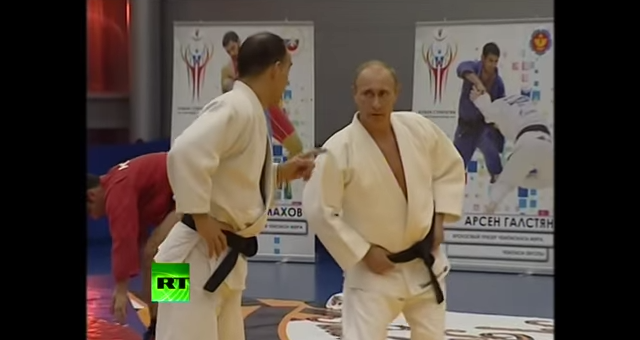 Vladimir Putin warms up for judo